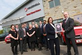Susan Hughes (second right), Vauxhall's network development manager, presents Chris Catterall (far right) and the Bristol Street Motors Keighley team with the Vauxhall Customer Excellence Award.