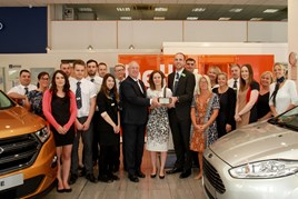 Bristol Street Motors Ford Cheltenham team receive the Chairman Award from Ford's Louise Coates