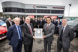 Everlasting Love: John Watchman (centre left) receives an award in recognition of his service from Jass Singh, general manager at Bristol Street Motors Vauxhall Sunderland