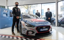BTCC racer Tom Ingram with Bristol Street Motors Hyundai Nottingham sales manager Justin Iliffe and general manager James Orridge