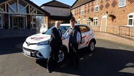 James Martin, managing director at Budgen Motor Group, with golfer Lee Towler