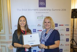 Caroline Hazlehurst receives her Leader of the Future award from Karen Myers, executive director of communications at The R&A