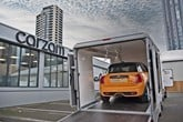 A Carzam car transporter containing a Mini Cooper S home delivery online sale