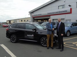 Colin Dyer, chief executive of WellChild (left), with Bruce Simpson, group operations manager of CCR Mitsubishi