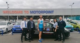 ​Motorpoint Peterborough employee Chris Northern (centre) with his supportive work colleagues