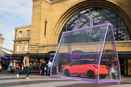 A Toyota Yaris in a giant shopping bag outside Kings Cross Station to promote cinch