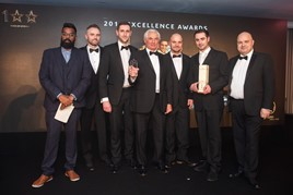 J & A Rigbye & Sons employees celebrate their awards hat-trick at the annual Citroën dealer awards alongside comedian and host Romesh Ranganathan