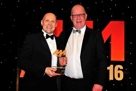 Colin McAllister, group training and development manager, John Clark Motor Group (left), collects his award from Mike Macaulay, head of corporate sales, AutoProtect