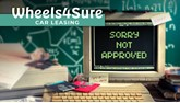 Wheels4Sure logo with old computer showing 'sorry not approved' message