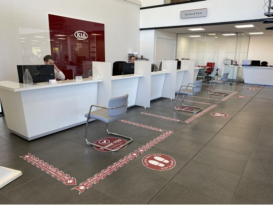 Socially distanced service reception at a Kia dealership under COVID-19 coronavirus experience