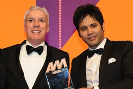 Dale Wyatt, director automobile,  Suzuki GB, collects the award from Khusro Kamal, chief executive, Car Finance Giant, right