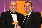 Darren Bradford, general manager, Drayton Motors, collects the  award from Martin Peters, sales director, Autoclenz Group, right