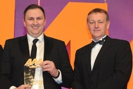 Darren Cuthbertson, franchise  director, Peter Vardy CarStore Glasgow, collects the award from Keith Bell, national accounts director, Barclays Partner Finance, right