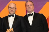Darren Edwards, chief executive, Sytner,  collects the award from Dave Woodman, UK and Ireland business development manager, MOTUL, right