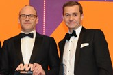 Darren Edwards, chief executive,  Sytner, collects the award from Richard Jones, managing director, Black Horse, right