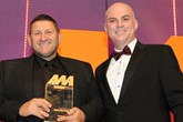 Dave Wright, corporate quality manager, Norton Way Motors, collects the award from Stewart Grant, commercial director, Santander Consumer Finance, right