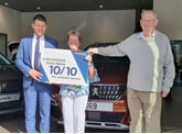 Simon Bailes Peugeot celebrates customer Elizabeth Hutchinson as Peugeot UK's most dedicated car owner