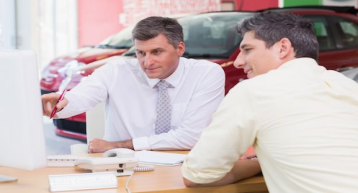 Dealership sales exec and customer