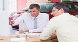 Dealership sales exec and customer