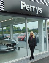 Perrys director Denise Millard outside Perrys Mazda Canterbury