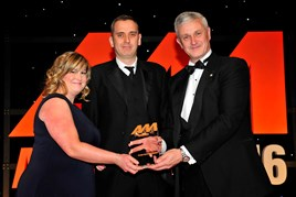 Arnold Clark Automobiles managing director Eddie Hawthorne, right, and Carol  Fairchild, group marketing and product development manager, left, collect their award