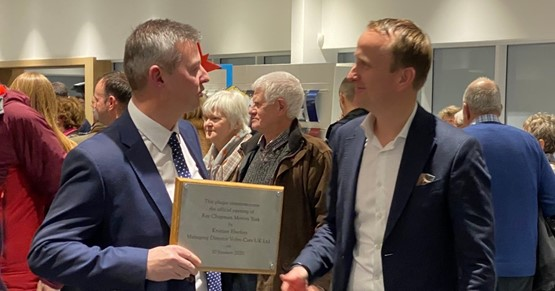 Volvo York dealer principal, Duncan Chapman, is presented with a commemorative plaque by Volvo Car UK managing director Kristian Elvefors (right)