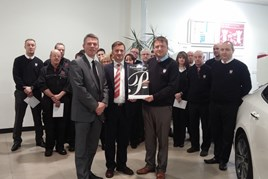 Kia Motors UK CEO Paul Philpott (centre, left) presents Flear and Thomson directors Scott Buchanan and Paul Buchanan with the dealership's Platinum Prestige Award