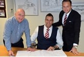 New signing (from left): Chorley Group chairman Andy Turner welcomes Phil Lambert alongside sales director Adam Turner