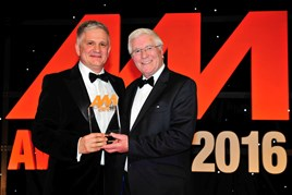 Gary Savage, chief executive, Mercedes-Benz UK (left), accepts the award on behalf of City West Country from John Boseley, managing director, Diamondbrite Automotive