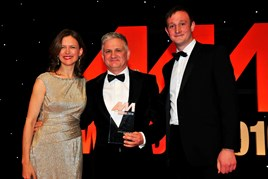 Gary Savage, CEO, Mercedes-Benz UK, accepts his award from host Katie Derham, and Simon Webb, head of sales and development, Premia Solutions (right)