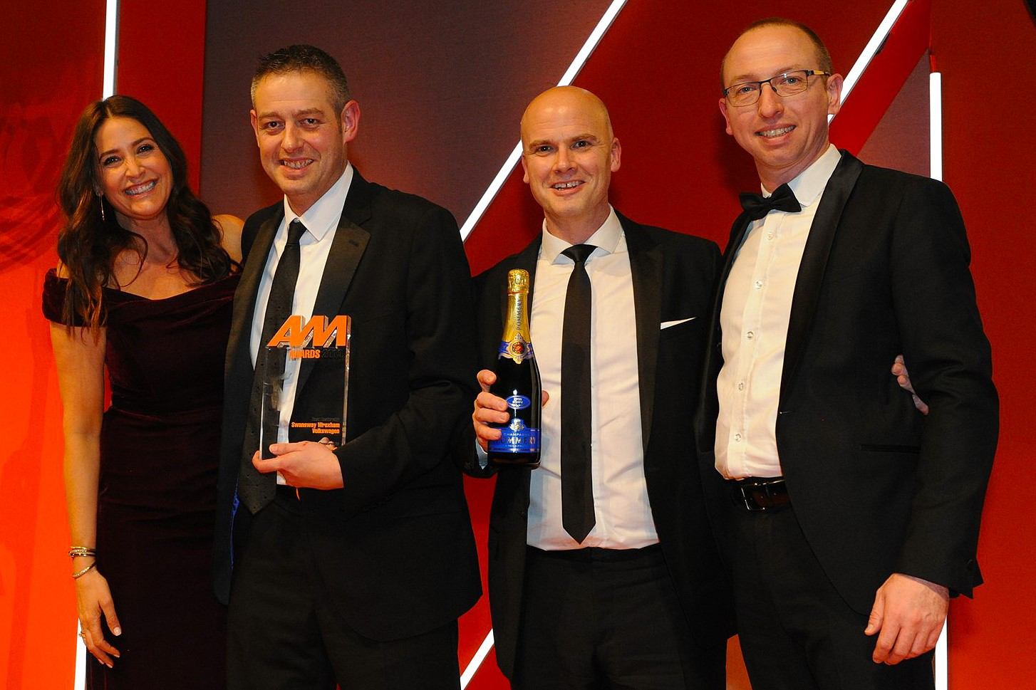 Gary Wood, brand manager, second from left, and Ben Gilbert, brand director, second from right,  accepts the award from Bertrand Scheenaerts, European  business development manager, Rhino Events, right, and Lisa Snowdon, left