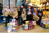 Swansway Group employees pack gifts for less fortunate children.