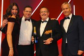 Gordon Veale, general manager, Carbase, (second from right) and Alex Jones, marketing manager (second from left) collects the award from Robert Hutchinson, sales director Motor Finance, BNP Paribas Personal Finance, right and host Lisa Snowdon left