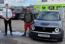 Guy Martin purchases Honda e at DM Keith Honda branch in Grimsby