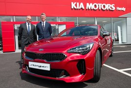 Hendy Group chief executive Paul Hendy (left) with Paul Philpott, president and CEO, Kia Motors (UK) at the opening of the new Kia Hendy showroom in Portsmouth with the new Kia Stinger
