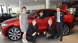 Farnell Jaguar Bolton general manager James Boyd and visitors from Harper Green School