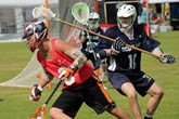 Peter Vardy's Jamie Fleming in Lacrosse action