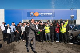 Jason Hurt, Motorpoint Sheffield general manager pops champagne at the new site