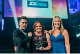 Anna-Lisa De Voil (centre) collects her Engagement Leader of the Year accolade at the Engagement Excellence Awards