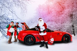 Feeling festive: JCT600 colleagues Kirsty Temple, Nicola Waugh and Gary Wilkinson with a Ferrari 599 GTO