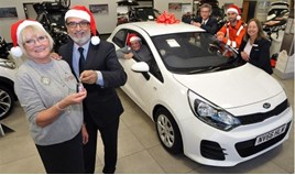 Jennings Motor Group managing director, Nas Khan, hands raffle prize winner Kath Mewse the keys to her new Kia Rio