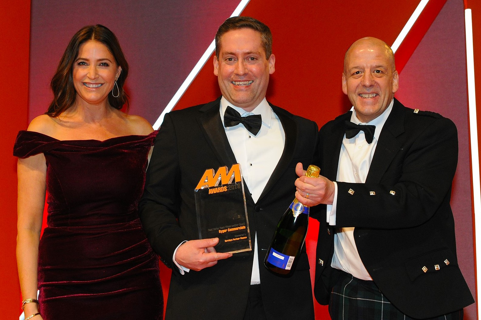 John Keogh, sales director, Rygor Commercials, collects the award from Alex Watt, regional sales  director, Barclays Partner Finance, right, and host Lisa Snowdon, left