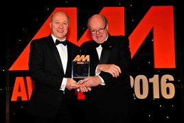 John Oakley, aftersales manager, Crewe Audi (left), collects the award for Best Service Reception Team from Christopher Macgowan, chairman of the judges