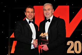 John Vilums, general manager, Perrys Vauxhall Doncaster (right), accepts his award from Stephen Briers, editor-in-chief, AM