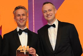 Jon Wakefield, managing  director, Volvo Car UK, collects the award from Andrew Hooks, chief operating officer, carwow, right