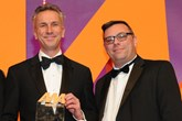 Jon Wakefield, managing director, Volvo Car UK, collects the award from Chris Benham, key account manager, Supagard, right