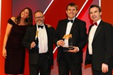 Jonathan Gravell, managing director, Gravells of Kidwelly, second from right, and Ian Gravell, general manager, second from left, accept the award from Lance Boseley, marketing director,  Jewelultra (manufacturers of Diamondbrite), right, and host Lisa Snowdon, left