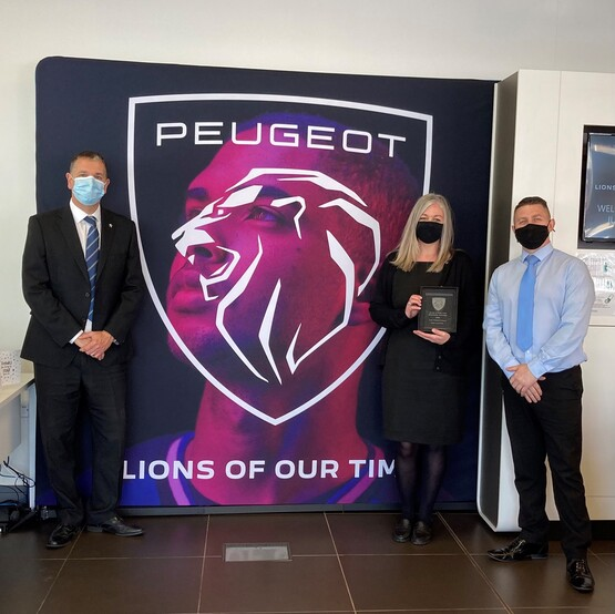 Zoe Cockroft of Just Motor Group with her Peugeot Guild of Gold Lion award