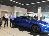 Kevin Abbs collects his Nissan GT-R from Jass Singh, GT-R specialist at Lookers Nissan Leeds