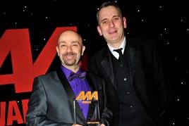 Kevin Davidson, retailer development director at BMW Group UK, collects the award for Best Manufacturer Digital Innovation from Jeremy Bennett, head of digital, AM